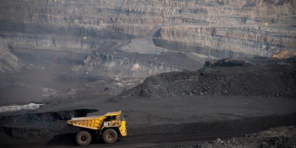 Big,Yellow,Mining,Truck,Hauling,Rock,In,Dusty,Coal,Mine